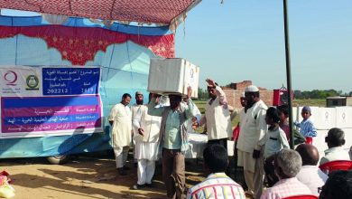 Qatar Charity distributes food baskets to flood victims in India
