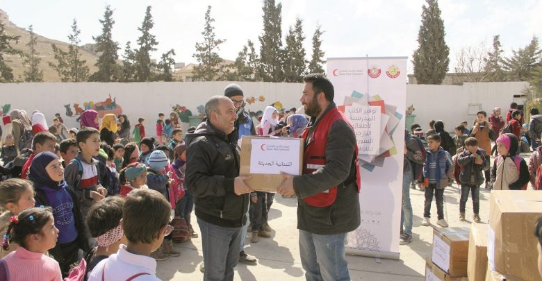 QRCS distributes winter aid to Syrian refugees