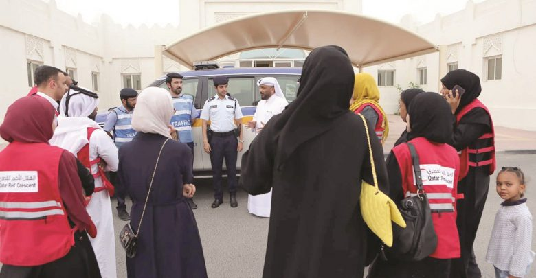 QRCS volunteers hold charity visits, distribute Iftar meals