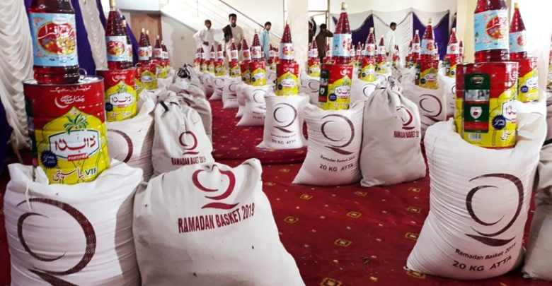 QC distributes food baskets and Eid clothes in Pakistan