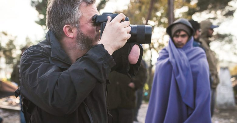 Humanist photographer Giles Duley interviews community in Qatar