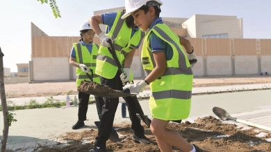 Photo of QIS students plant trees as part of beautification drive
