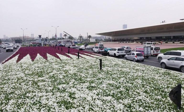 Qatar flag of flowers decorates the cornice