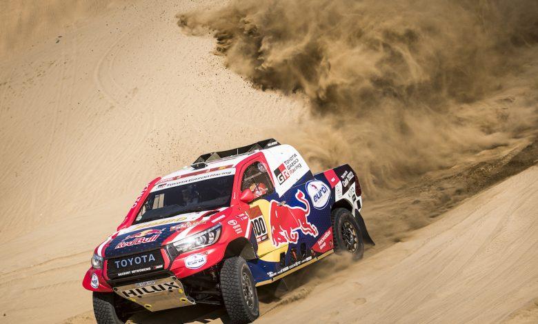 Rally Champion Nasser Al Attiyah turns engine on at the 2020 Dakar; Rally Start Podium in Saudi Arabia