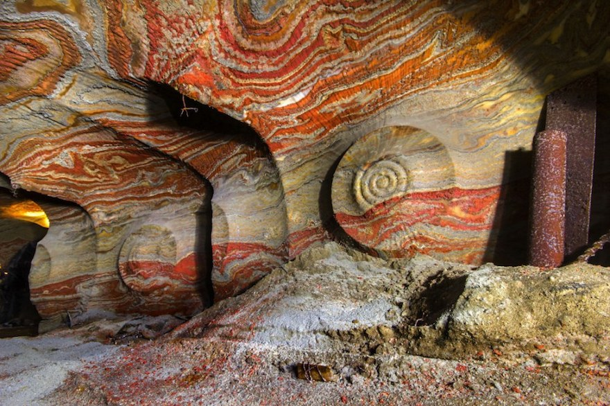 PIC BY MIKHAIL MISHAINIK / CATERS NEWS - (PICTURED The psychadelic walls inside the abandoned salt mine in Yekaterinburg, Russia) These psychedelic photographs give a rare glimpse inside the walls of an abandoned salt mine. After years of mining deep into the Earths crust, layers of a carnallite now line the tunnels with a spectacular mix of coloured rock. Used in the process of plant fertilisation, the mineral can appear in a variety of colours including white, red, yellow and blue. Although a small part of the mine is still in use, miles of tunnels now lay abandoned & are only accessible with a special government permit. SEE CATERS COPY **NOT FOR SALE / USE IN RUSSIA / POLAND**