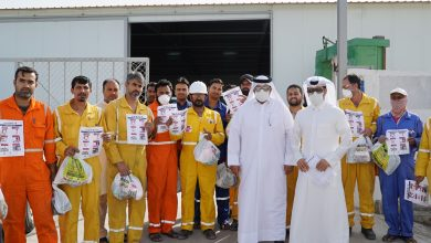 Photo of Qatar Charity distributes personal hygiene and food items and educational flyers to workers