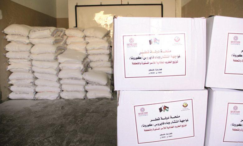 Qatar panel distributes food parcels to needy Gaza families