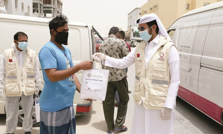 QFC, Qatar Charity donate protective kits to Industrial Area workers