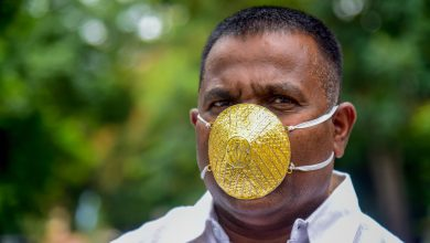 Photo of Indian man wears gold face mask to ward off coronavirus