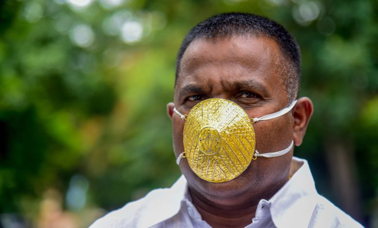 Indian man wears gold face mask to ward off coronavirus
