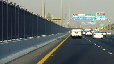 Iron barriers to prevent pedestrians from crossing Salwa Road