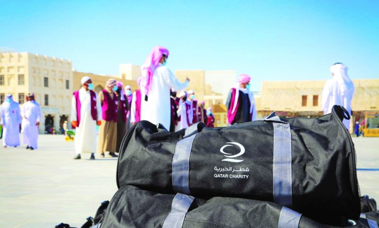 Qatar Charity continues to distribute winter bags to workers
