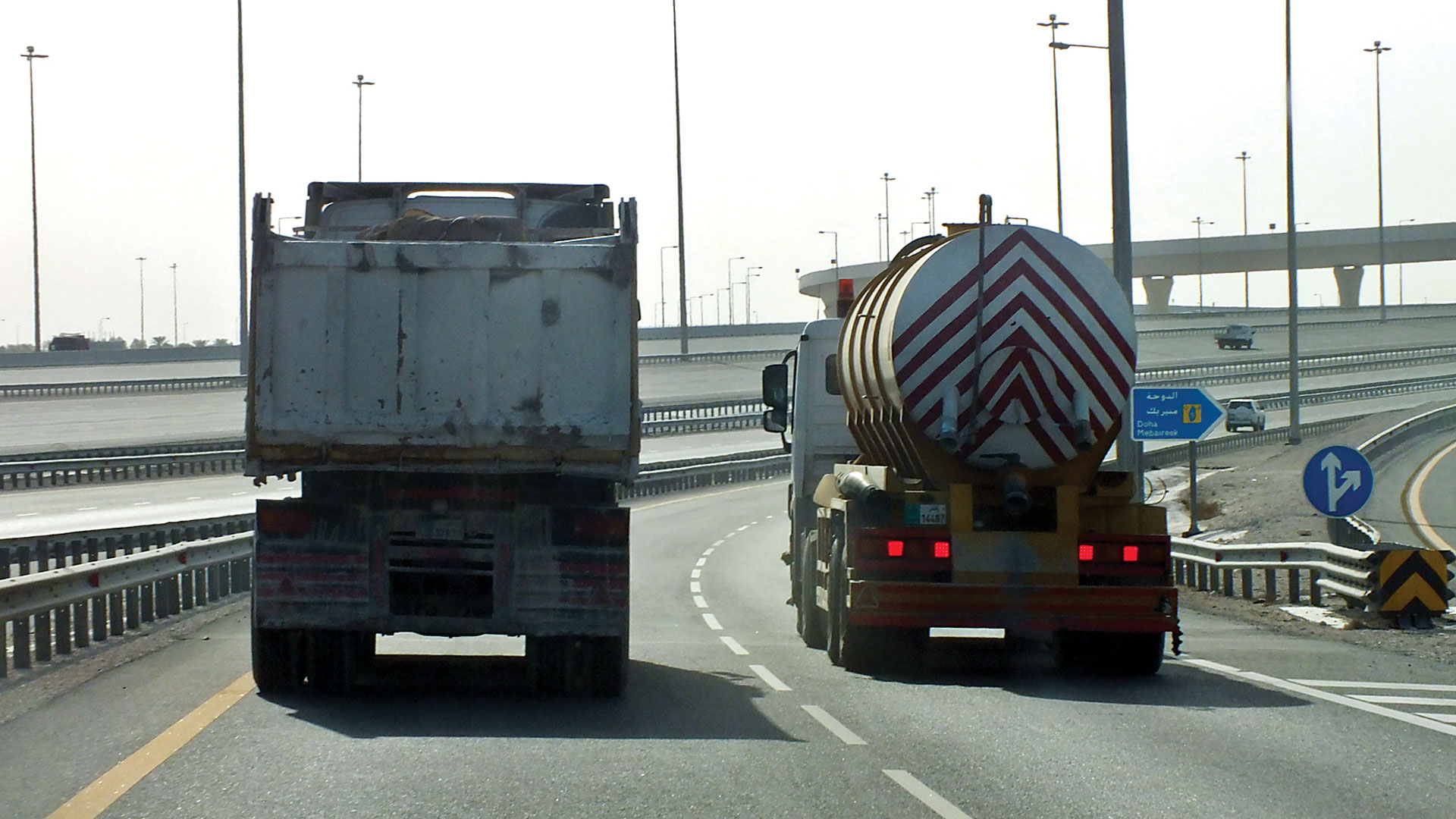 Trucks switching lanes on bridges; a source of danger