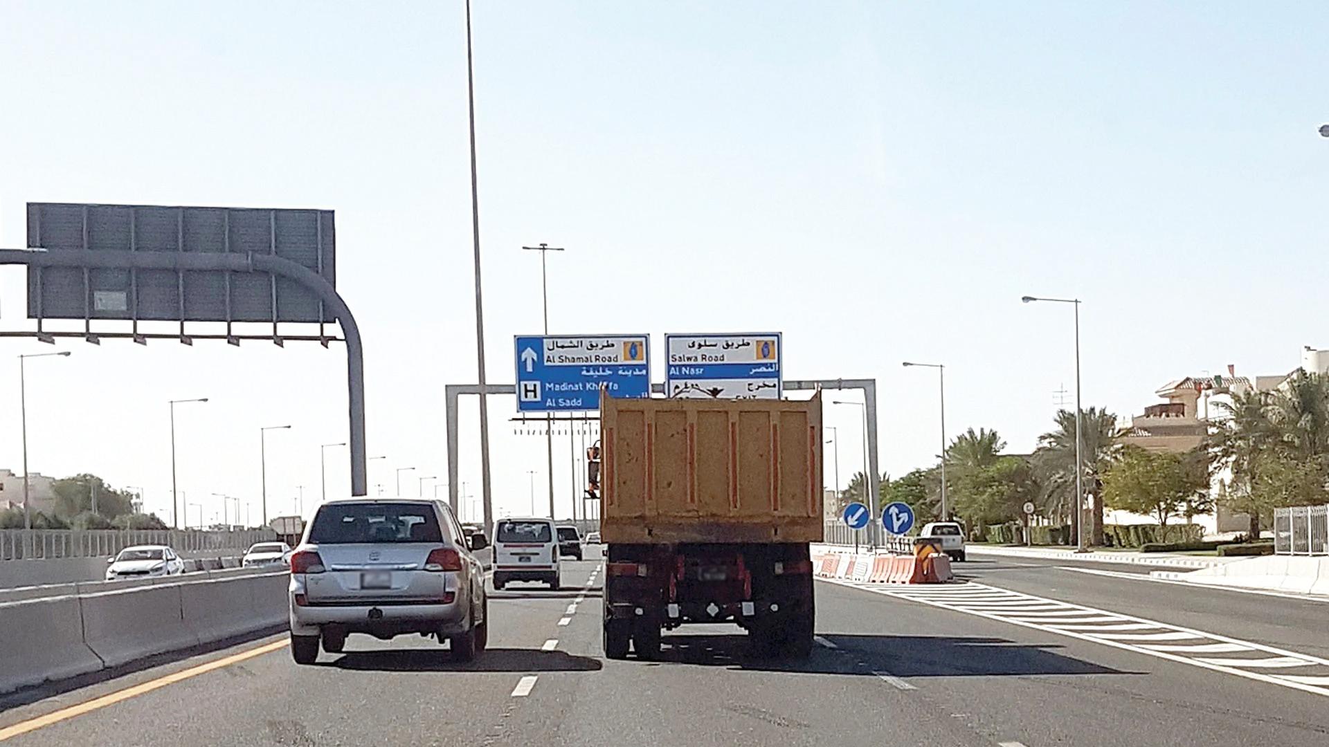 Trucks driving in center lanes