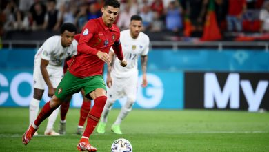 France top group, Portugal squeeze into last 16 after 2-2 draw