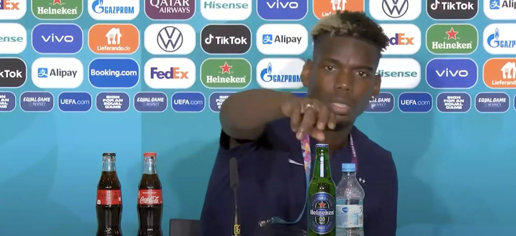 Paul Pogba removed a bottle of beer from a press conference