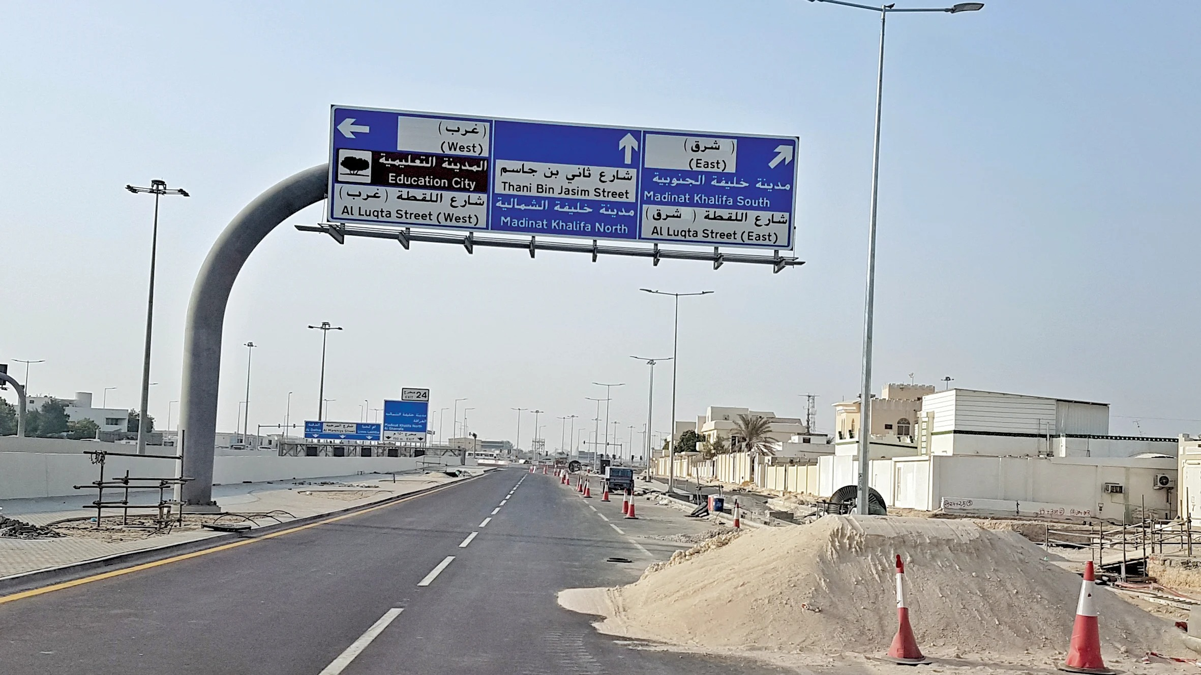 Sand obstructs a road in Gharrafat al-Rayyan