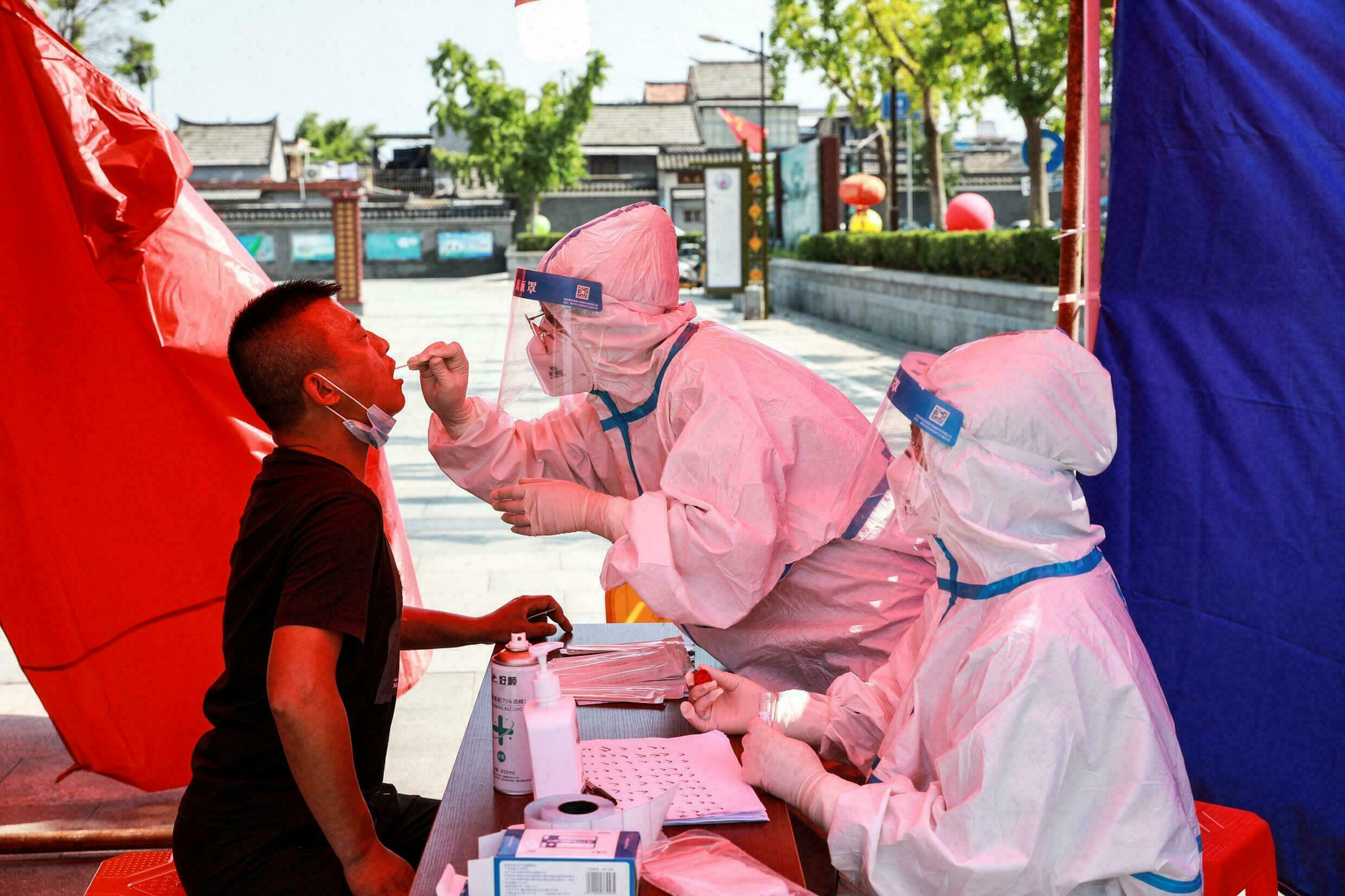 China's Wuhan to test 'all residents' amid return of Covid-19