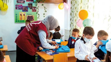 QC Distributes School Bags To Orphans in Kyrgyzstan