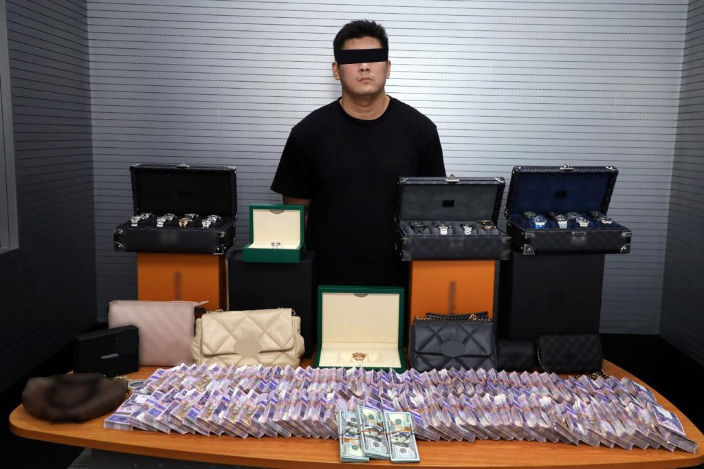 Expat arrested for engaging in investment without licenses