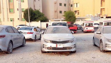 Abandoned cars distort the streets of New Al-Hitmi