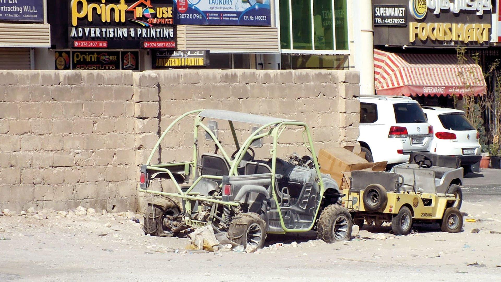 Abandoned cars and bikes in Bin Mahmoud