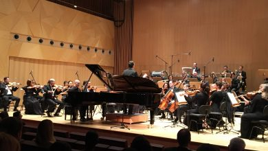 Qatar Philharmonic Orchestra performs football anthems